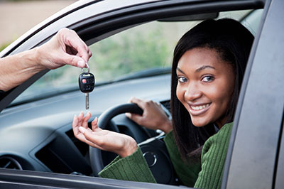 Young girl being given car keys